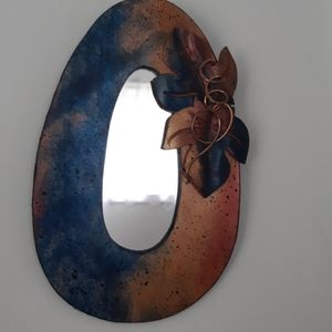 Leather and copper trimmed mirror